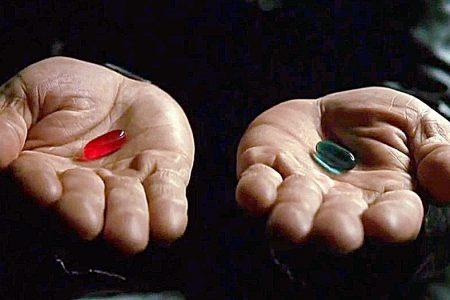 still shot from The Matrix two hands each offering a pill