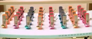 picture of 31 metronomes clicking in unison